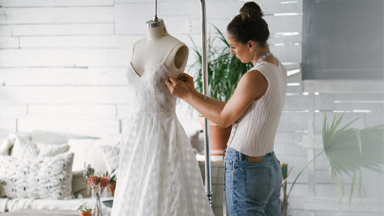 A fashion designer creating gowns; image used for HSBC Smart Loan Against Property page