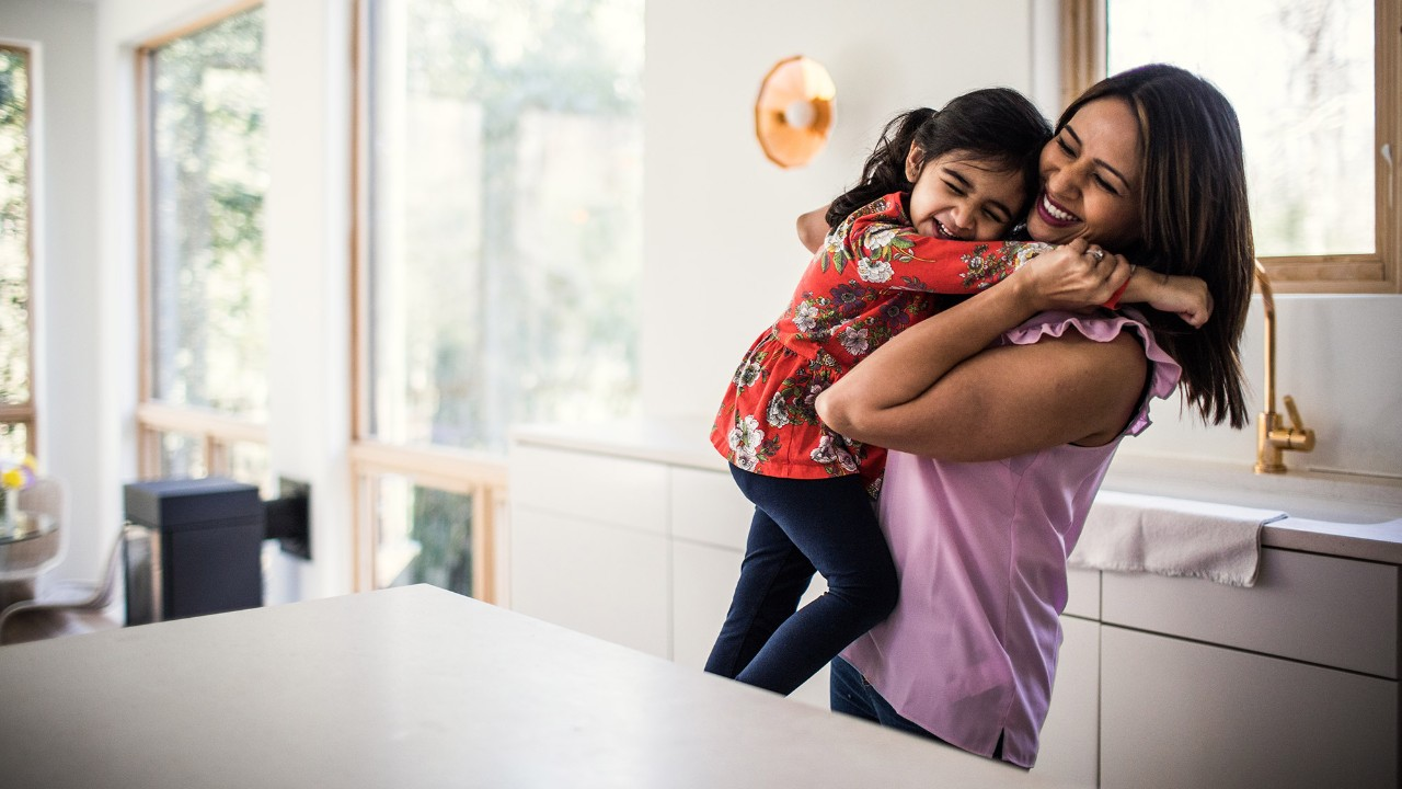 A mother and daughter are embracing; image used for HSBC wealth insights page.