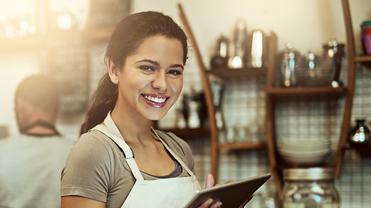 A barista is smiling; image used for HSBC Loan Against Property page.